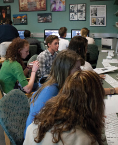 Students practice hands-on video editing at CMU Media Day 2013. Photo by Ella Lowenberg, Montrose High School.